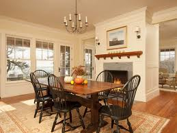traditional dining room with stone fireplace u0026 crown molding