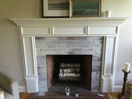 interior whitewashing brick fireplace white wash brush paint