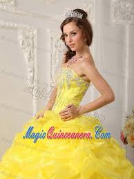 appliques and flowers dresses for a quinceanera in bright yellow