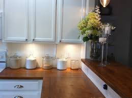 100 white kitchen cabinets with butcher block countertops