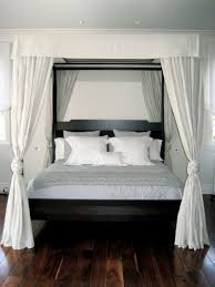 bedroom fashion canopy bed design and stylish wall mirrors in chic