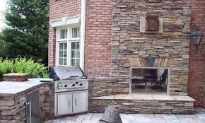 outdoor patio kitchens double sided indoor outdoor fireplace