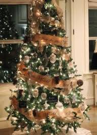 christmas tree decorating with burlap ribbon and pine cones