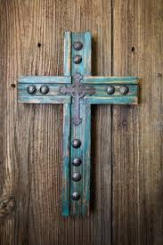 take wood cross and nail pieces of paper with prayer intentions to