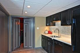 remodeled basement with kitchenette kraftmaid slate stained maple