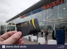 man holding merseytravel walrus card travel smartcard at liverpool