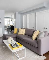 gray sofa with chaise lounge and yellow pillows contemporary