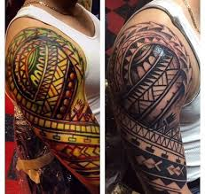 black and grey with colorful tribal tattoos on right half sleeves