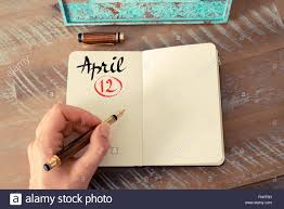 writing paper with space for picture concept image of april 12 calendar day with empty space for text concept image of april 12 calendar day with empty space for text as handwritten note with fountain pen on a notebook