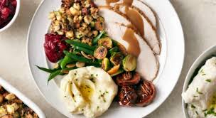 2014 thanksgiving statistics how much turkey do americans eat on