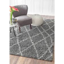 gray shag rug trendy living room photo in houston with gray walls
