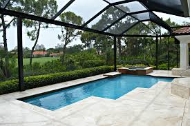 aluminum pool screen enclosure with custom pavers by design pro