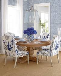 round dining room with white bamboo chairs contemporary for blue