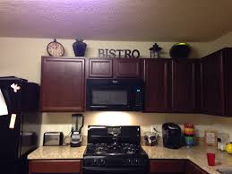 Interesting Decorations On Top Of Kitchen Cabinets Stop Right - Decor for top of kitchen cabinets