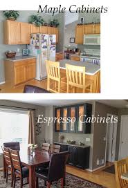maple cabinets with black island ask maria must my kitchen coordinate with the dining room maria