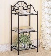 three shelf decorative black metal side table with sunburst accent