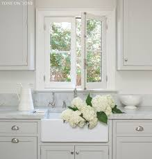 gray kitchen cabinets with white marble countertops bring the garden inside home kitchens kitchen remodel