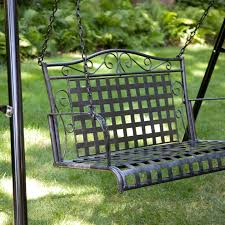 exterior brown wooden swing a frame with chain and wooden seat