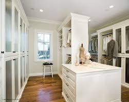 home design closet island with glass cabinet door and hanging