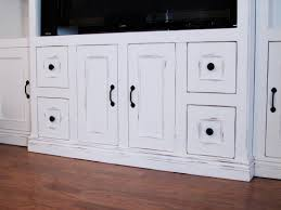 White Laminated Flooring Classy White Entertainment Center With Storage And Cream Rug On