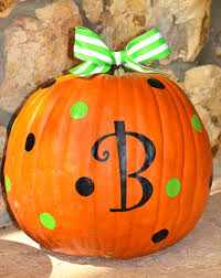 adorable monogrammed and polka dot pumpkin decorating for