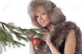 fur christmas the woman in furs decorates a christmas fur tree on a white