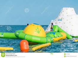 beach toys and equipment floating in the sea inflatable slide
