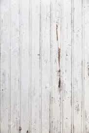vertical white wooden paneled shabby chic wall stock photo