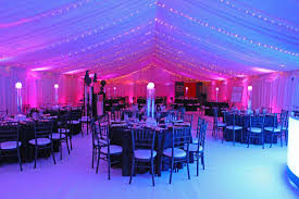 marquee interior with fairy lights blue and pink lights and black