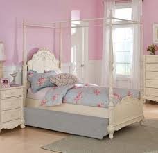 bedroom carved white wooden canopy bed with curved headboard and bedroom carved white wooden canopy bed with curved headboard and trundle having pink floral pattern blue bedding bed added by white wooden bedside table