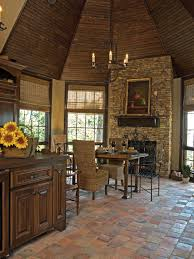 small kitchen idea with rustic kitchen floor and fireplace