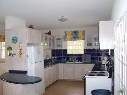 Simple Small Kitchen Design Kitchen White Wooden Kitchen Cabinet With Black Counter Top Feat