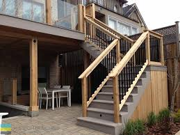 pvc deck with glass railings and walkout basement m e