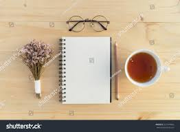 writing concept papers blank opened notebook teacup flowers on stock photo 321947684 blank opened notebook with teacup and flowers on table writing concept