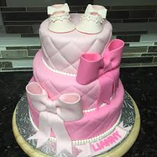 3 shades of pink baby shower cake with 2 big bows and elegant