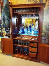 custom made bar cabinets upcycled repurposed armoire converted into a dry bar liquor