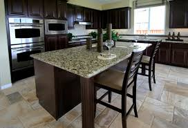long dark brown wooden kitchen island with gray granite top