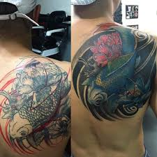 color flower and koi fish on right back shoulder by luis k