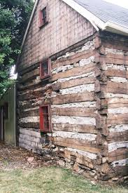 300 year old log house discovered hiding underneath stucco facade
