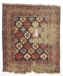 antique east caucasian snowflake design rug probabaly shirvan