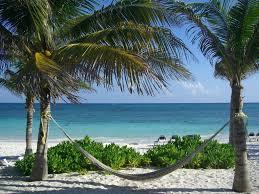 hammock on the beach at the hotel grand palladium kantenah resort