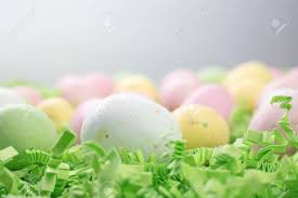 malted easter eggs malted candy easter eggs laid on a bed of green crepe paper stock