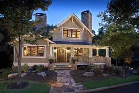 craftsman exterior of home with fence by brookstone builders