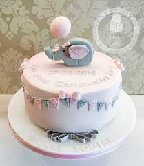 little elephant christening cake decorated with pink and grey