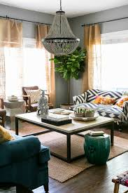 living rooms brown curtains beige sofas high window green walls