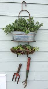 simple wall hanging planter created from recycled shower caddy