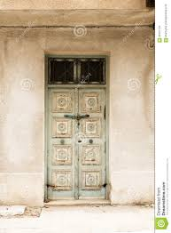 locked wooden front door of the old house with big lock stock