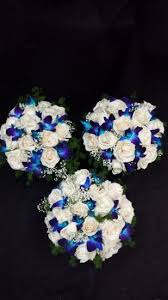 white and blue roses white roses blue orchids baby s breath set white roses blue
