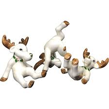 trio tumbling fitz floyd ceramic reindeer figurines