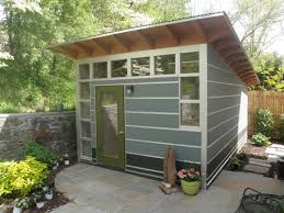 small shed design with glass door and windows in natural stone